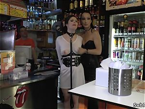 mistress in leather dominates gimp in public