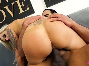 big-boobed blonde Nina Elle taking a giant dark-hued manstick