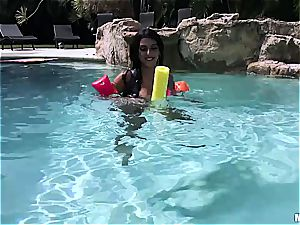 All inborn black-haired Latina in pov act next to the pool