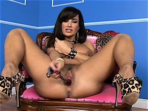 cool Lisa Ann inserts her faux-cock deep in her moist slit