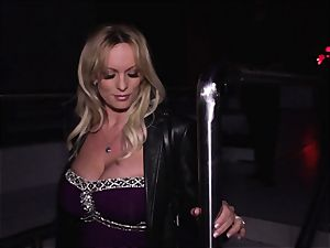Stormy Daniels inhales off a stranger in the back seat