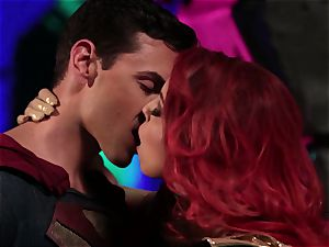 Britney Amber inhales off a ultra-kinky superhero