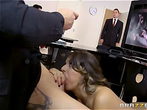 Workmates watch as Cara Saint-Germain pounds in the office