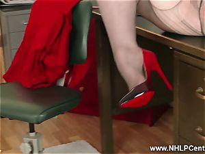 red-haired cougar frigs muff on office desk in pantyhose