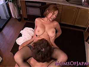 asian mommy in stockings glides rod in her cell