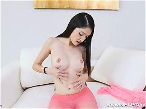 diminutive stunner in pinkish sheer nylon tights thumbs pussy